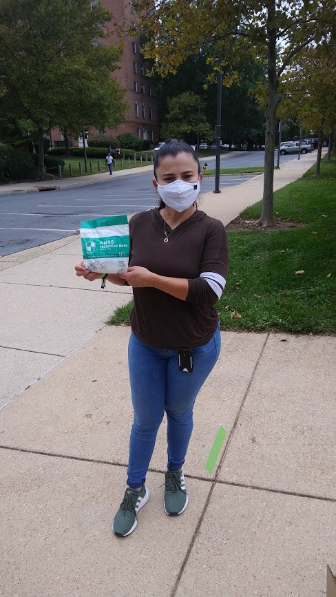 AFSCME member Maria Ayala holds up masks