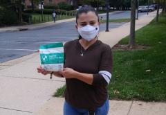 AFSCME member Maria Ayala holds up masks