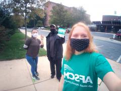 AFSCME members distributing masks